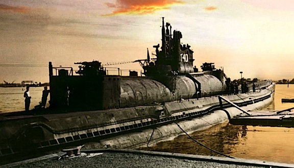 In one of the last photos of an I-400 taken before its heading out to sea (and subsequent capture by the US Navy), this peaceful sunset image (colorized B&W) provides a good view of the sub's unusual round aircraft hangar and a few sailors for a sense of scale. (Photo: Rtas Vaduum)