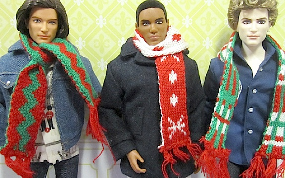 Raquel Castro's assorted Ken dolls model 3 of the new 1:6 scale Christmas scarves now available at all Target stores. (Photo by )