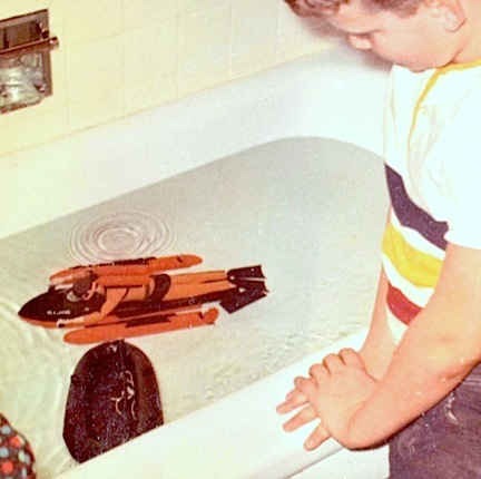 A young Tim Weedn playing happily with his new GIjOE Sea Sled and black spy raft, circa Christmas morning, 1966. (Photo: Tim Weedn)