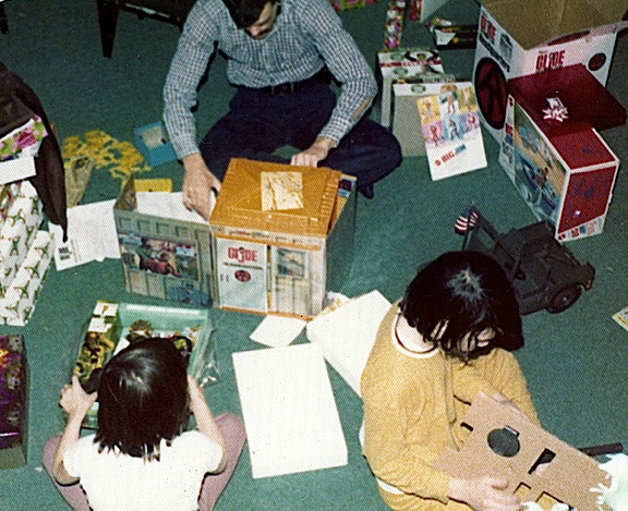 We love a photo that tells a story. We assume the little boy on the right, trying to remove the 5-star Jeep recoiless rifle from its cardboard packing is the recipient of all this great GIjOE and Big Jim swag. But notice that the Dad (center) can't help but get his hands busy setting up that Adventure Team HQ. And the little brother (left) is already opening the Deep Sea Diver equipment set. It's a GIjOE Christmas, circa 1972! (Photo: Will Ceau)