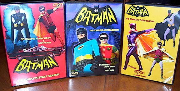"Calm down, Bat-fans. These are fakes. Such illegally duplicated, amateurishly packaged, criminally distributed and sold VHS and DVD copies of the original Batman TV series have been ""pirated"" in the open online for decades. Occasionally, legal pressure was brought to bear on the perpetrators, but others quickly took their place on ebay and websites specializing in video sales. Now, for the first time EVER (legally), Warner Brothers has officially announced its plans to release the entire series on licensed, professionally remastered DVDs. Hooray! (Photo: mista shake speer)"