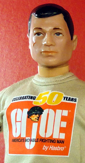 """A forlorn vintage GIjOE looks towards an uncertain future while wearing one of the """"unofficial"""" 50th t-shirts provided free to fans from Patches of Pride. (Photo: Mark Otnes)"""