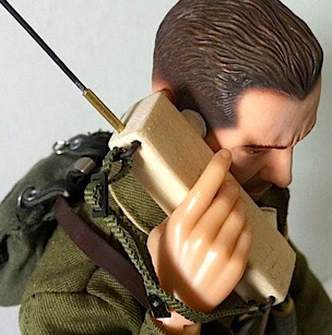 "The first call comes in on Mike's new handcrafted 1:6 walkie-talkie: ""Hello? What's that you say? You want to buy Mr. Conrad's 1:6 scale wooden tank? HA. Get in line, fella!"" (Photo: Mike Conrad)"