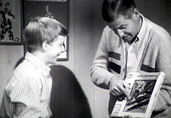 "In the first of 3 newly discovered vintage GIjOE commercials from 1964, child actor Paul O'Keefe reacts as ""Dad"" shows him a new GIjOE equipment set. The first of the three 1-minute commercials was recently premiered for the first time EVER (since it was last seen 50 years ago) on Matt McKeeby's ""Vintage3djoes.com"" website. (Screenshot: Matt McKeeby)"