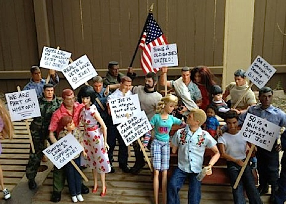 Fans and collectors of 12-inch GIjOEs are beginning to publicly air their displeasure regarding Hasbro's disdainful treatment of an American toy icon on what SHOULD BE its wonderful 50th Anniversary. This group of Joes and their Barbie girlfriends gathered outside the house of collector Laura Ann Ostermeyer recently, waving placards and shouting slogans in hopes of getting Hasbro's attention and receiving the recognition they deserve. (Photo: Laura Ann Ostermeyer)