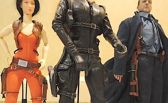 All of Luck's creations all completely handmade. Look at that unusual 4-gun righ on the leather-clad female spy in the foreground. And check out Bruce Willis' extended side-holster. AMAZING work! (Photo: Mark Otnes)