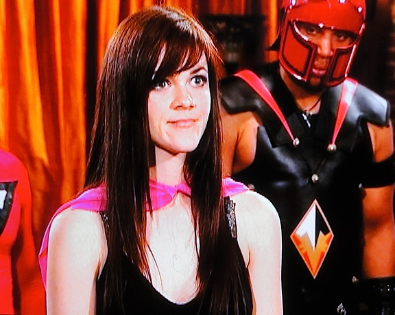 As fellow contestant E. Quincy Sloan looks on, Weld defends herself for one last time before Stan Lee finally eliminates her from the show. (Photo: Syfy)