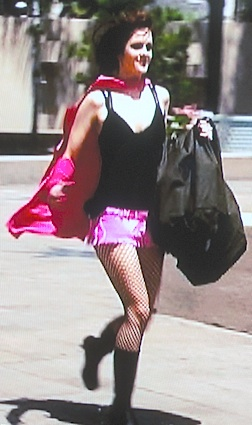"Chelsea demonstrated that running in high-heel superhero boots is not as difficult as you may think in this scene from ""Who Wants to be a Superhero?"" (Photo: Syfy)"