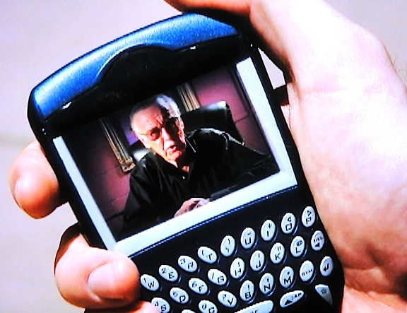 "In 2006, there was no Skype, so Stan Lee's ""communicators"" were still considered to be very high-tech. Too bad they were just non-functioning props. (Photo: Syfy)"