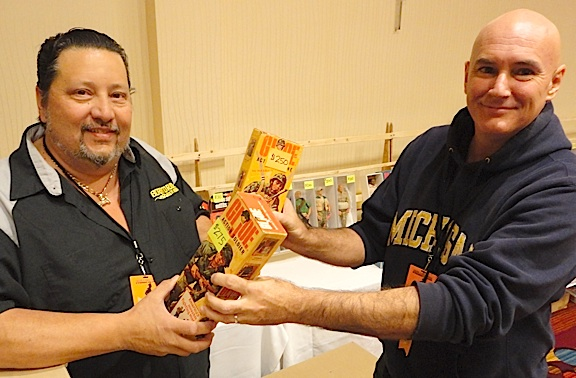 Passing the torch of Joe fandom, Jim Besse of New York (right) hands over two of the MANY figures he recently sold to fellow GIjOE fan and collector, Ron Galletti of Florida (left). Galletti and Besse had just completed negotiations on possibly the largest deal EVER conducted at Joelanta, with Galletti paying Besse $5,000 for his entire collection. (Photo: Mark Otnes)