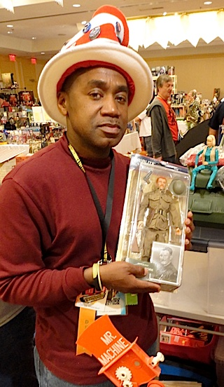 "GIjOE fan and toy dealer, Carlos Morrison, holds up the MIB ""Sergeant York"" action figure he had just won as one of Patches of Pride's ""instant winners"" at Joelanta 2014. Free packets of ""PoP Rocks"" candy were handed out by members of PoP's elite ""Dirty Dozen"" volunteers, and on the back of Carlo's pack of candy was a sticker declaring him as an ""instant winner!"" After showing the candy wrapper to one of the Dirty Dozen, he was awarded his free gift. Now THAT'S ""Joe Karma!"" (Photo: Mark Otnes)"