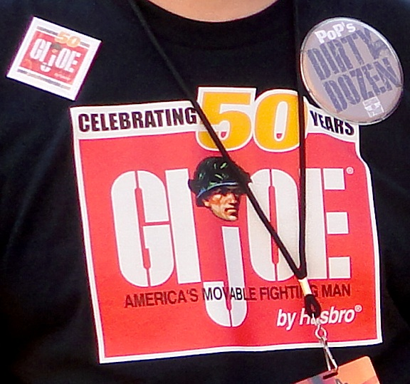 "This closeup reveals that each member of PoP's ""Dirty Dozen"" received a free ""unofficial"" 50th Anniversary GIjOE t-shirt, a special ""Dirty Dozen"" button, and one of the ultra rare-n-square 50th Anniversary pin-on buttons. Sweet! (Photo: Mark Otnes)"