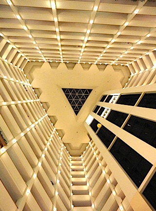 "This is the vertigo-inducing view fans have when they look up in the triangular atrium at the Marriott. If you look carefully, you'll notice a yellow-parachuted GIjOE is drifting perilously close to ""the void"" of the three elevator shafts. This Joe did indeed, go into the void, and ended up snagged up on a cable. His ultimate fate remains unknown. (Photo: Mark Otnes)"