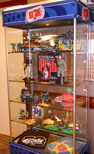 Every year, the GIjOE Collector's Club uses this same display case to show off its convention exclusive figure sets, t-shirts and other premiums. This year, the lackluster