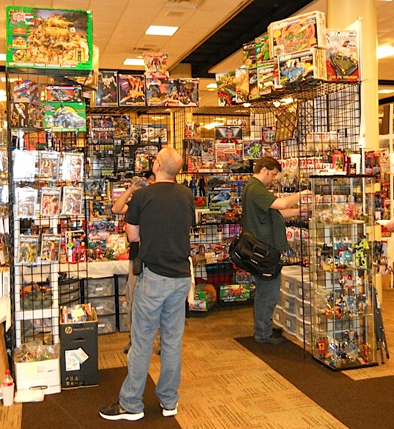 Some dealers at JoeCon 2014 clearly made the most of their limited display space by building their shelving up, up, UP! While such display tactics may help them show more merchandise, it's questionable whether buyers pay as much attention to items placed high above eye-level. (Photo: Brad Byers)