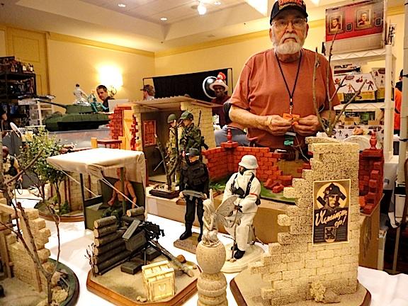 Mini dorama and display stand creator, Joe Hodge, mans his booth at Joelanta 2014. A quick glance at his products reveals superb craftsmanship. (Photo: Mark Otnes)