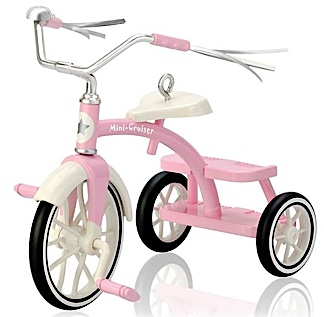 "The ""Pretty Pink Trike"" keepsake ornament measures approximately 3""l x 2.5""h x 1.5""w and would make an ideal decor item for a 1:6 scale Christmas diorama. Love that chrome! And yes, the wheels turn. (Photo: Hallmark)"