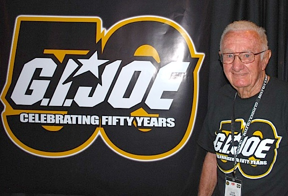 GIjOE co-creator and icon, Sam Speers, alongside a 50th Anniversary banner at JoeCon 2014 in Dallas, TX. (Photo: GIJCC)