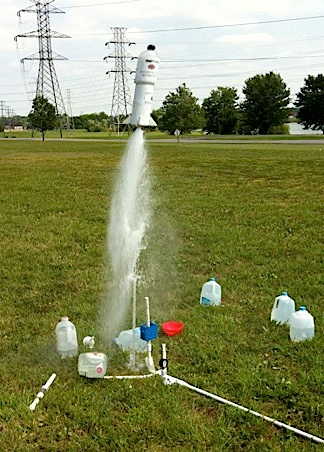 This photo (taken during a previous club meeting) reveals jugs of water and other related launch detritus used to repeatedly provide thrust for the 1:6 scale parachute GIjOE missions. Out-STANDING! (Photo: KYGIJCC)