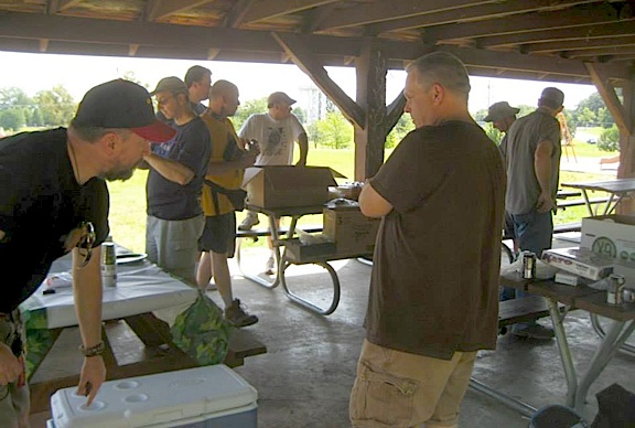 KYGCC members gather underneath the park's pavilion to discuss and prepare for the day's events. (Photo: KYGCC)