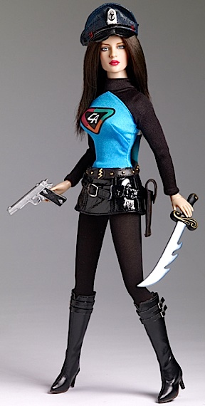 "Tonner's new Lady Action DOLL would make GIjOE look like a runt. She tops in at a whopping 18"" tall and features a large Barbie-like head, straight black hair, barely poseable body and mixed quality accessories and costume. Although some collectors of 1:6 scale Captain Action will want to ""pick her up,"" the lanky ""Lady A"" is quite expensive, created mainly for static display and does little to advance the collection of 1:6 CA fans. (Photo: Tonner)"