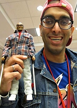 "GijOE fan and collector, Omar Syed, holds up his 1:6 scale ""mini-me"" action figure. (Photo: Omar Syed)"