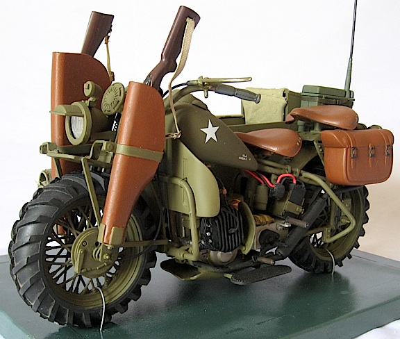 "Opposite view showing dual rifle scabbards, two seats, radio, saddlebag and unique ""tractor"" tires. (Photo:"