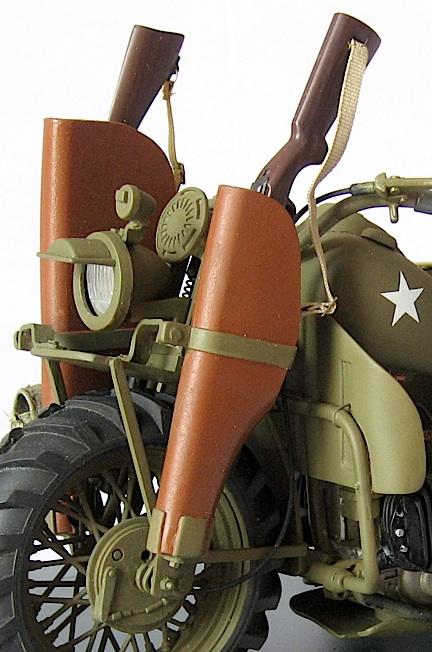 This closeup reveals the M1 carbine and Thompson machine-gun in their