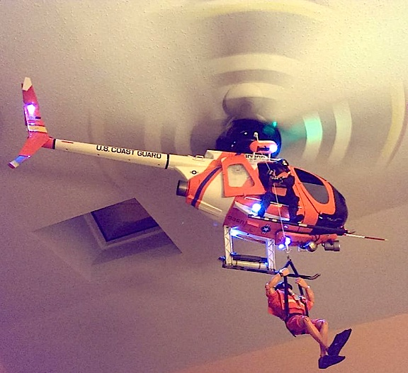 "Holy Rotors, Batman! Imagine ""flying"" this stunning 1:6 scale USCG HITRON ""Fast Attack"" Littlebird helicopter INSIDE your home—with just the flip of a switch. For creator/customizer, Tom McMurray, that's now become a daily reality. Lower the rescue diver! Aye-aye! (Photo: Tom McMurray)"