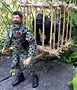 "One of D'Annibale's handcrafted bamboo cages works perfectly with this ""Capture of the Pygmy Gorilla"" scene. Outstanding! (Photo: Angelo D'Annibale)"