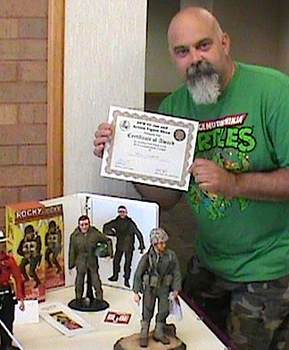 GIjOE collector and customizer, Bill Lawrence, holds up the award he won recently for the creation of superb replica of the first-ever GIjOE prototype. (Photo: Bill Lawrence)