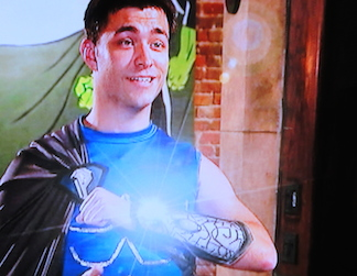"Give up my Armaguard? Would a Superhero sell the very object that makes them ""super?"" Not bloody likely! (Photo: Syfy)"