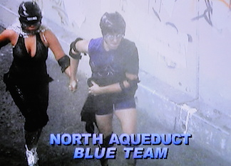 Many contestants struggled simply to remain standing while being blasted head-on by high-pressure fire hoses and wind-tunnel fans. In this screenshot, Williams can be seen aiding fellow team member, Trisha Paytas (Ms. Limelight) to run down the tunnel.