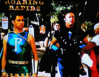 The realities and limitations of superhero costumes became apparent to all contestants during the Six Flags challenge which required running all over the park searching for clues. (Photo: Syfy)