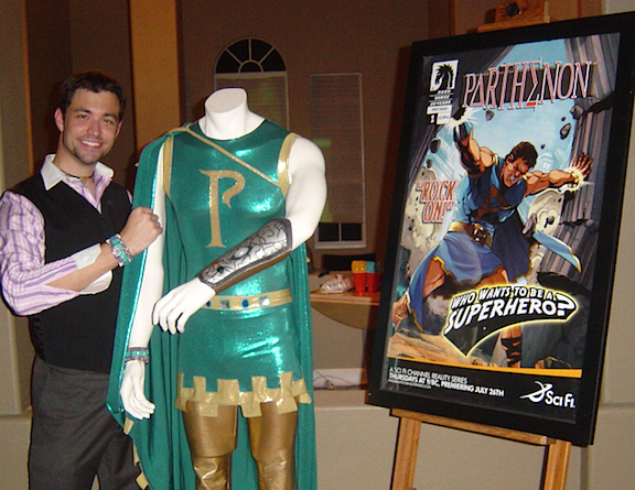 "What's Dan Doing? That's what we were determined to find out, in this, the 3rd in our series of exclusive interviews with contestants of Stan Lee's ""Who Wants to be a Superhero?"" Above, Dan poses with his two biggest and best souvenirs from the show, his original (Stan Lee-designed) Parthenon costume and the prototype comic book cover created by Dark Horse Comics. Excelsior! (Photo: Dan Williams) What's Dan Doing? That's exactly what we wanted to find out in this, our third exclusive interview with contestants of Syfy TV's reality competition show, Stan Lee's ""Who Wants to be a Superhero?"" Today we conduct an in-depth Q&A with Dan Williams, aka the superhero, ""Parthenon."" Here, Williams poses with two of his souvenirs from the show, an original (Stan Lee-designed) Parthenon costume and a poster for his character's (prototype) comic book by Dark Horse Comics. Excelsior! (Photo: Dan Williams)"