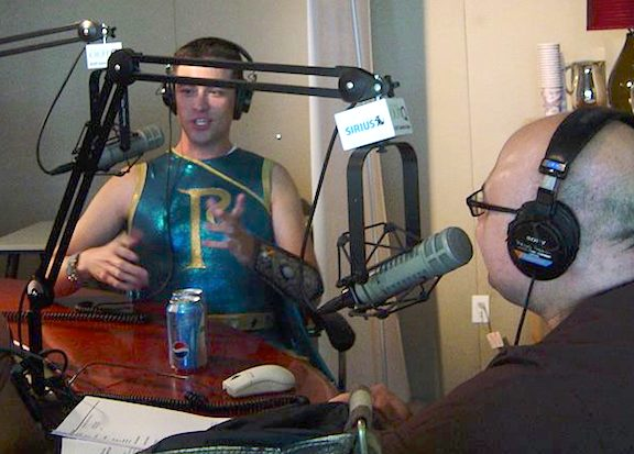 """Parthenon is On the Air! Williams' natural ease and comfort working with the media made him an easy selection to represent the show in NYC. Here, he responds to question posed by Sirius host,Frank DeCaprio (formerly of Comedy Central's """"Out at the Movies""""). (Photo: Dan Williams)"""