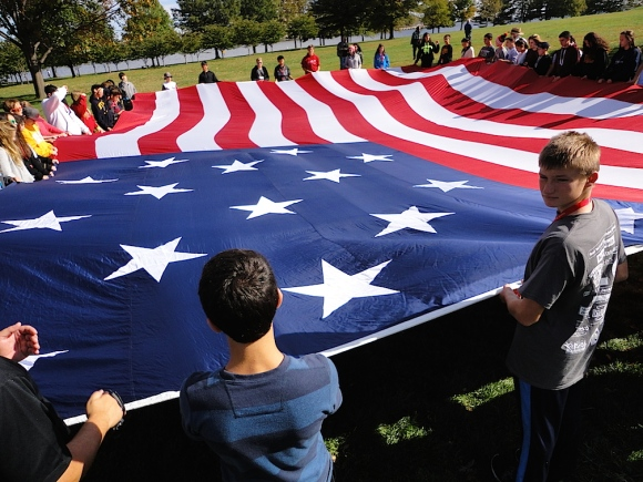 What a Flag! To demonstrate the actual size of the Star-Spangled Banner, Park Rangers host special presentations such as this flag-holding event enjoyed by a group of local students visiting the fort. (Photo: Mark Otnes)