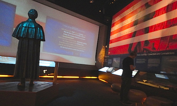 A superb bronze of Francis Scott Key stands in the middle of the theatre room, facing a giant video screen which surprises visitors by raising to reveal the actual fort and flag outside. Don't forget to stand! (Photo: Mark Otnes)