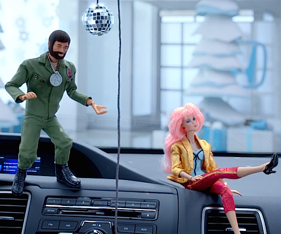 The Commander's at a loss to understand Jem's refusal of his offer to dance. Oh well, her loss! Also note that at this point, the animators have outfitted Joe with a traditional left hand. They switch his hand styles throughout the spot. (Photo: Honda)