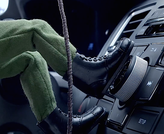 Step on it, Joe! In this extreme closeup, the Commander rappels up the climbing rope as his vintage boot stomps down hard on the radio dial, turning on seductive dance music. (Photo: Honda)