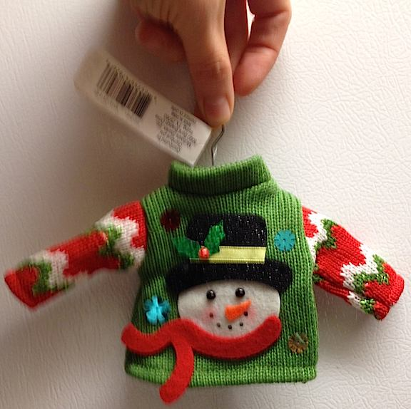 Oh, man. This 1:6 scale sweater's so bad—it's GREAT! Check out your local Michael's craft stores. They're being sold as ornaments on little hangers for just $ (Photo: Laura Ann Ostermeyer)