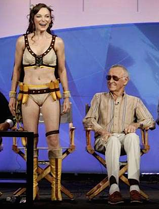 Comics legend, Stan Lee, enjoys his front row seat to Votava's fine-figured introduction of her Monkey Woman super heroine character. (Photo: Syfy)