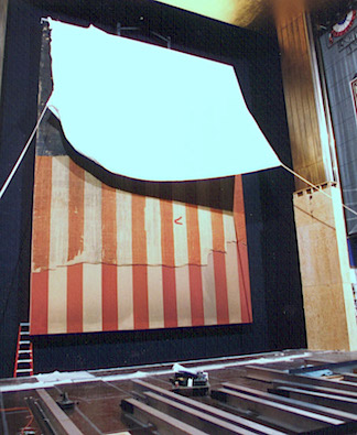 Stop the Madness! Before any more pieces were snipped away and lost forever, restoration experts at the Smithsonian began their arduous restoration of the flag. Note how much of the length had been lost already. What a shame! (Photo: Smithsonian)
