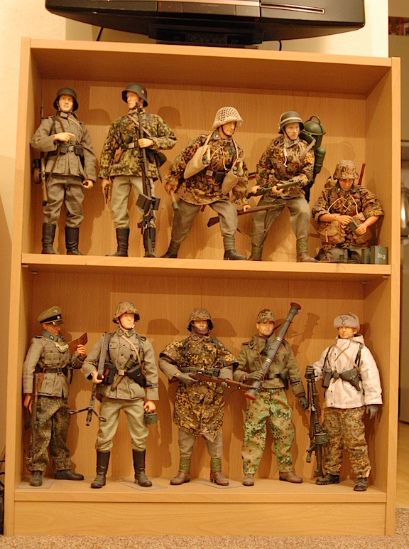 A closeup of another of Greg's shelved displays reveals superbly detailed 1:6 figures representing a wide variety of WWII forces. (Photo: Grzgorz )