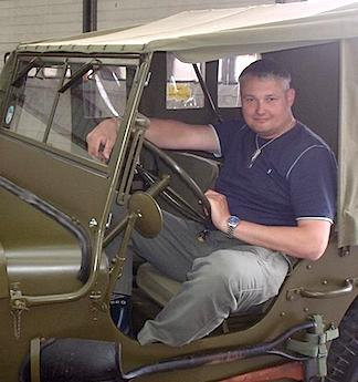 Remembering the Past— Greg poses in a fully restored U.S. Army Jeep, somewhere in the UK. (Photo: Grzegorz Borecki)