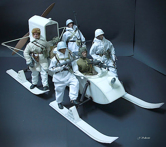 Soviet Snow Power! Sulowski's use of dark paper backgrounds is evident in this picture and helps his all-white Aerosan and snow troopers really stand out. WOW! (Photo: Jacek Sulowski)