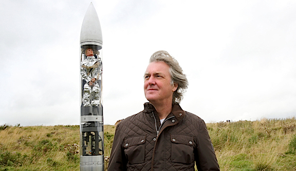 "British TV celebrity, James May, poses alongside a clear rocket containing an Action Man astronaut in this publicity still promoting an upcoming episode of his show, ""James May's Toy Stories."" (Photo: BBC)"