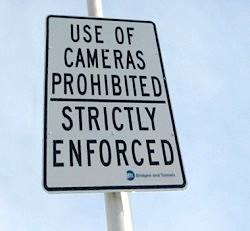 A recently posted sign warns photographers to keep their lens caps on. ARGH! (Photo: Tracey Evans)