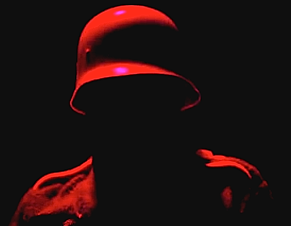 """Due to the numerous quick-cuts of the film, the """"enemy"""" was often hard to determine. Nonetheless, severe and ominous lighting was applied to the German soldiers, creating a menacing and threatening presence. (Screenshot: NFB)"""