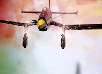 "This gas-powered Cox Stuka came to life, its machine-guns spitting bullets at the enemy down below. To create this effect, Munro attached simple firework sparklers to the plane and ""flew"" it towards the camera using fishing line. Ingenious! (Screenshot: NFB)"